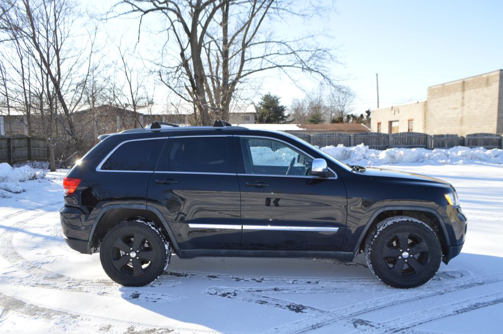 2011 JEEP GRAND CHEROKEE LAREDO for sale at TKP Auto Sales