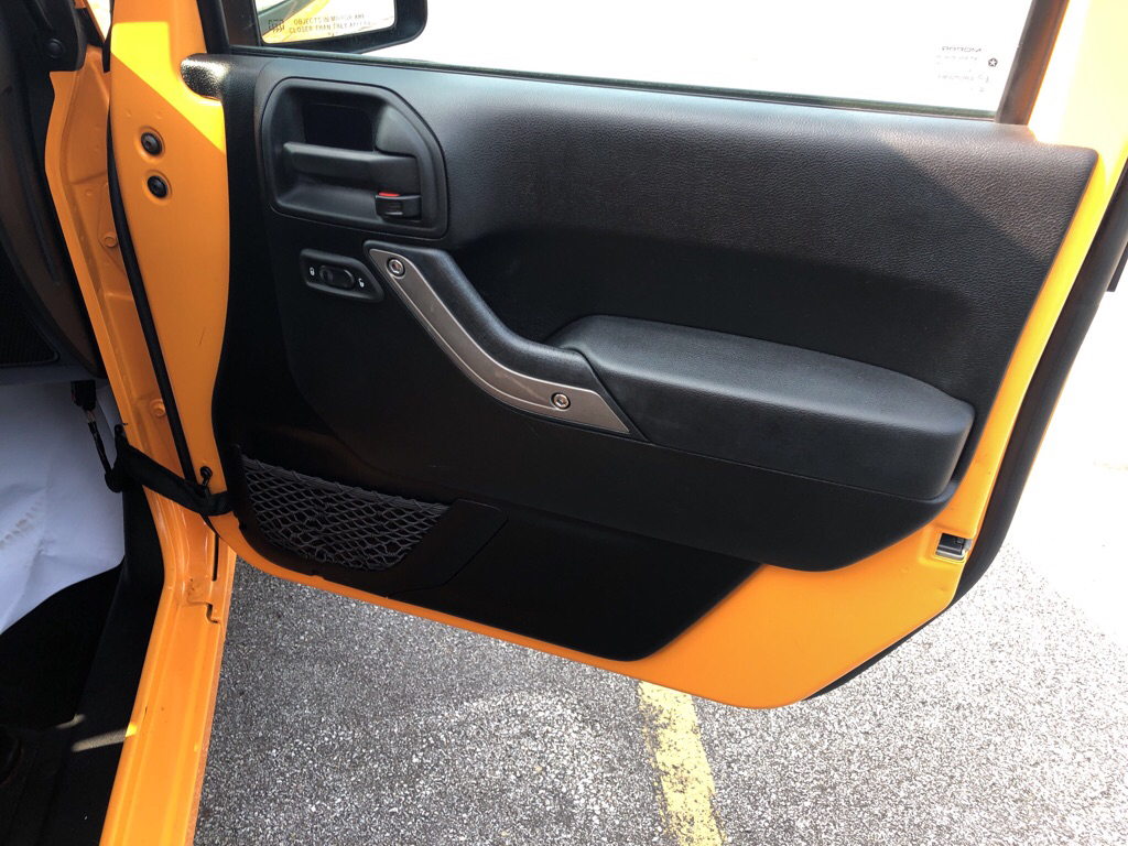 2012 JEEP WRANGLER UNLIMI SPORT for sale at TKP Auto Sales