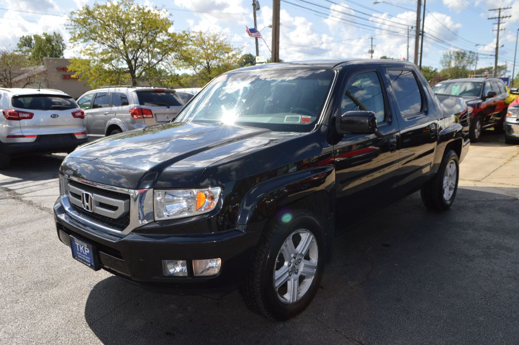 2011 HONDA RIDGELINE for sale at TKP Auto Sales