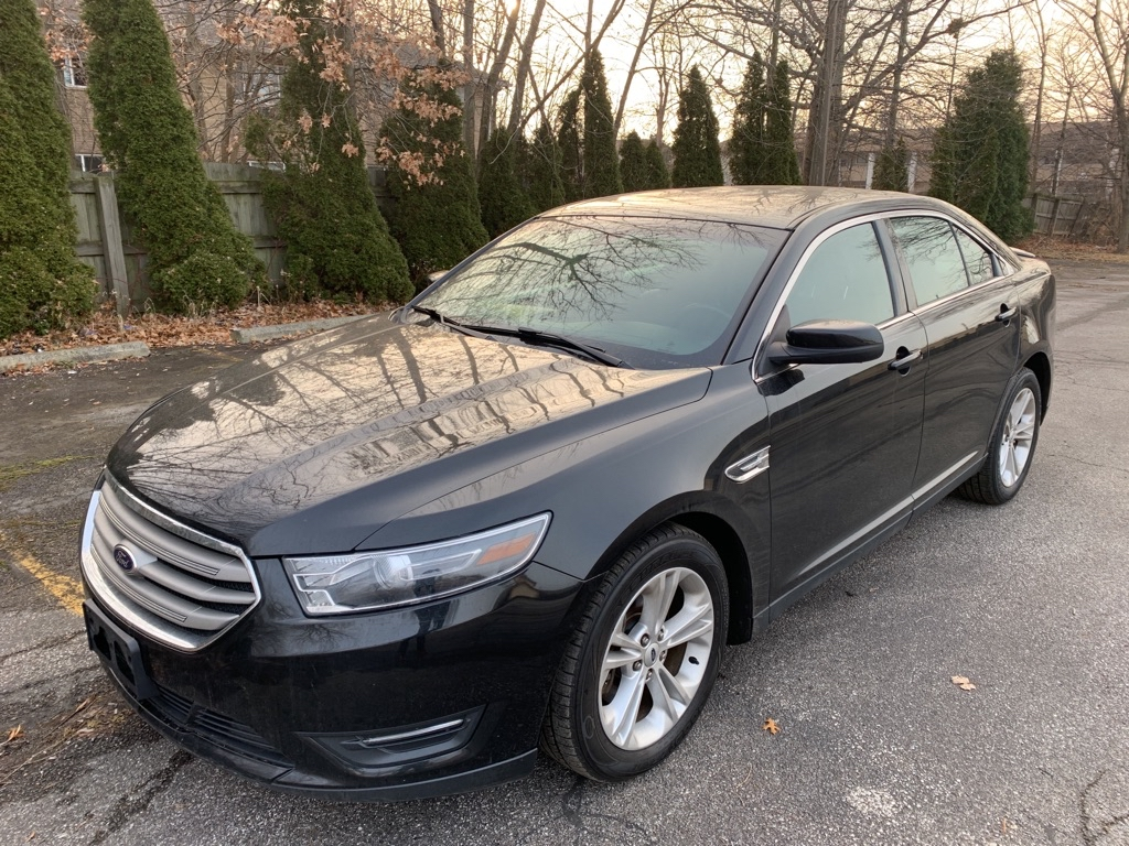 2014 FORD TAURUS for sale at TKP Auto Sales