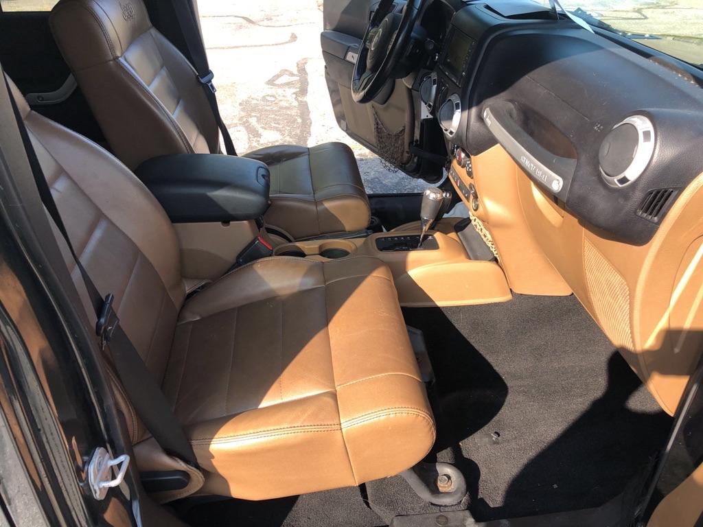 2011 JEEP WRANGLER UNLIMI SAHARA for sale at TKP Auto Sales