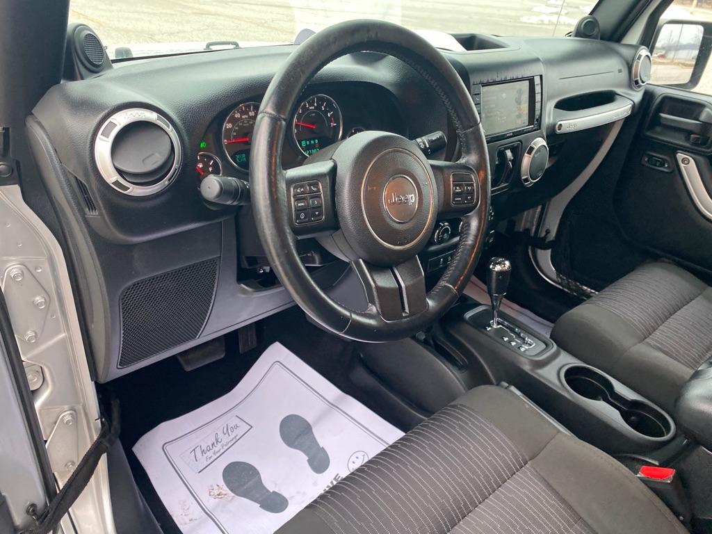 2012 JEEP WRANGLER UNLIMI SAHARA for sale at TKP Auto Sales