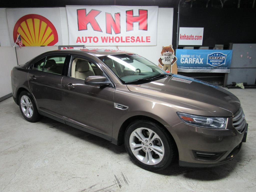 2015 FORD TAURUS SEL for sale at KNH Auto Sales