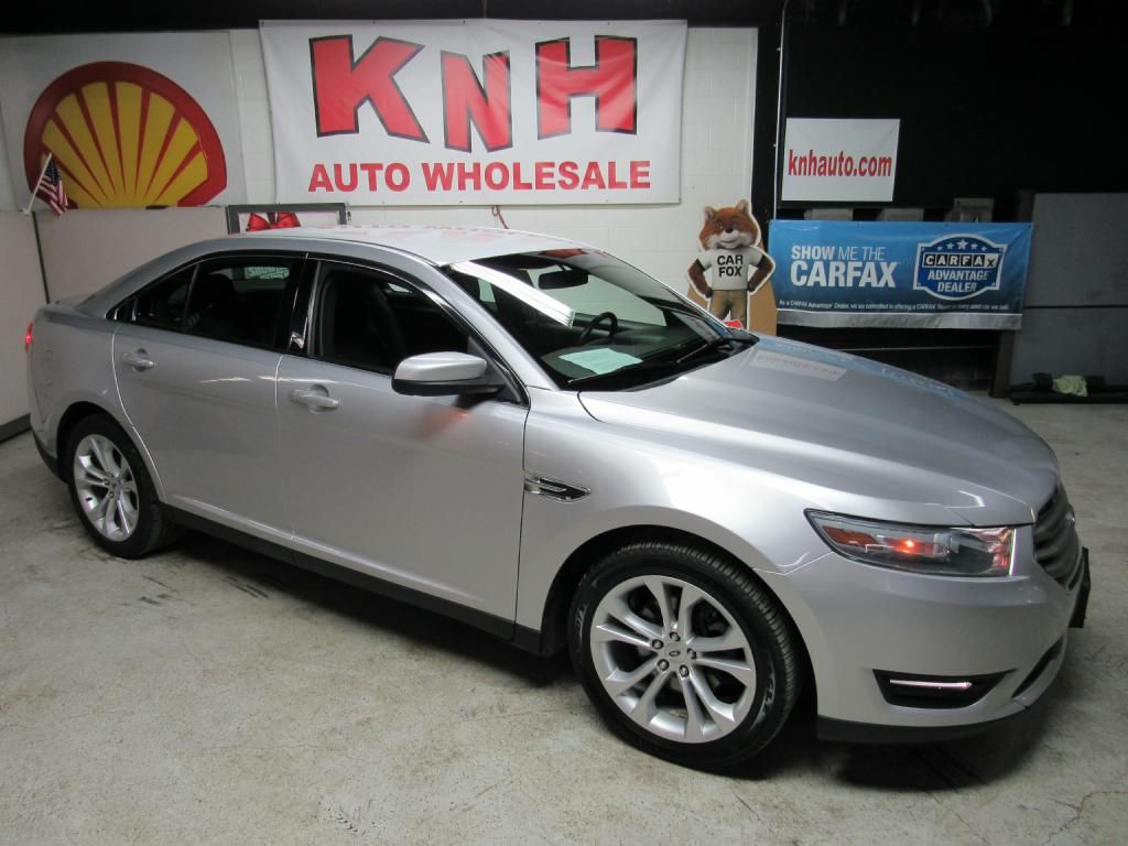 2013 FORD TAURUS SEL for sale at KNH Auto Sales
