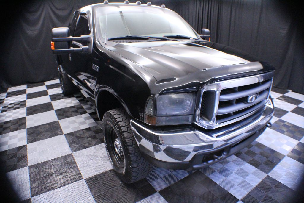 2004 FORD F250 for sale at Solid Rock Auto Group
