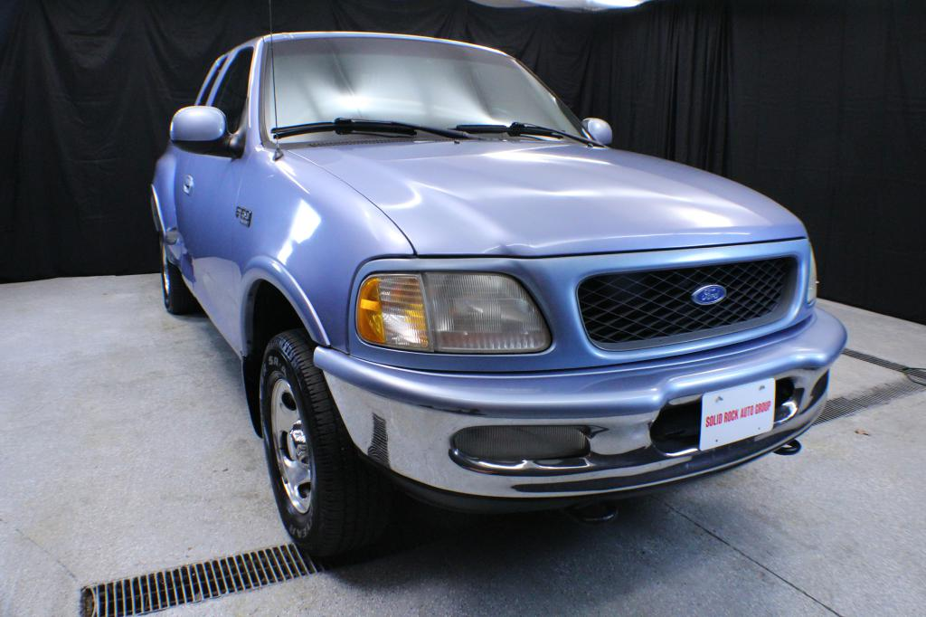 1997 FORD F150 for sale at Solid Rock Auto Group
