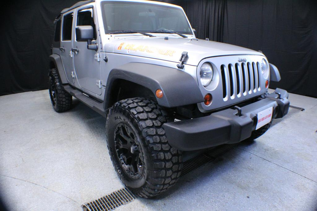 2010 JEEP WRANGLER UNLIMI for sale at Solid Rock Auto Group