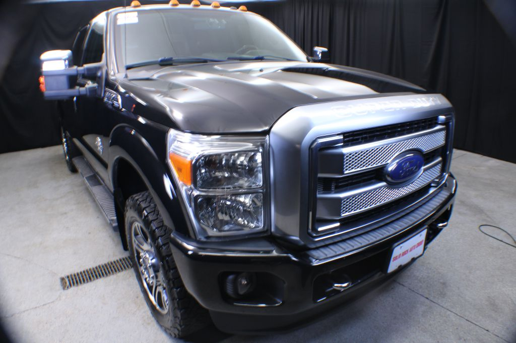 2013 FORD F350 SUPER DUTY PLATINUM for sale at Solid Rock Auto Group