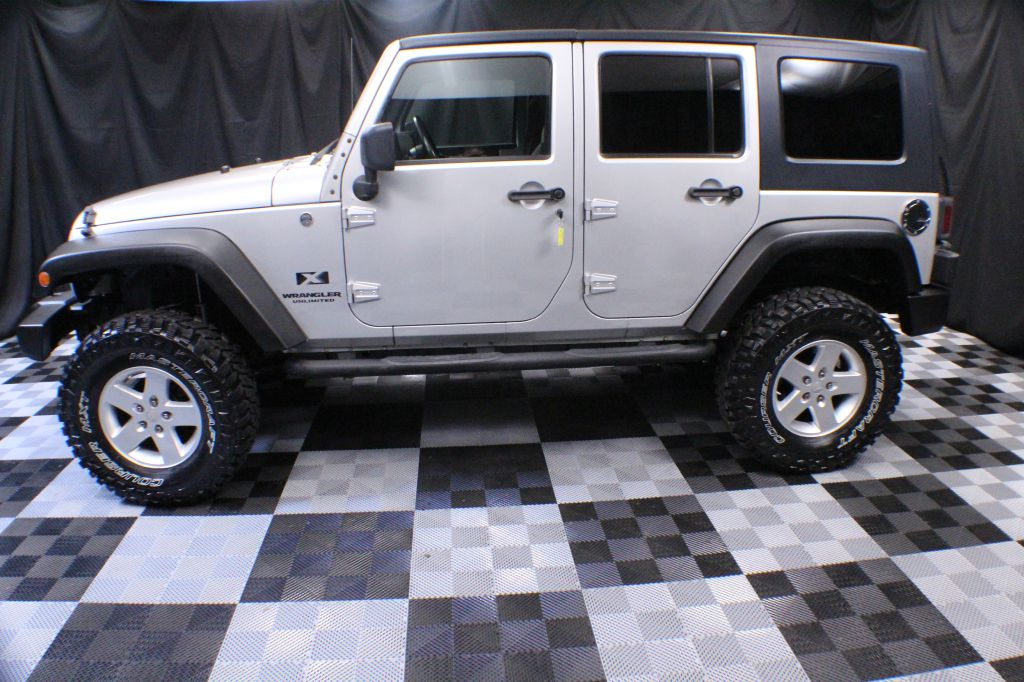 2009 JEEP WRANGLER UNLIMI X for sale at Solid Rock Auto Group