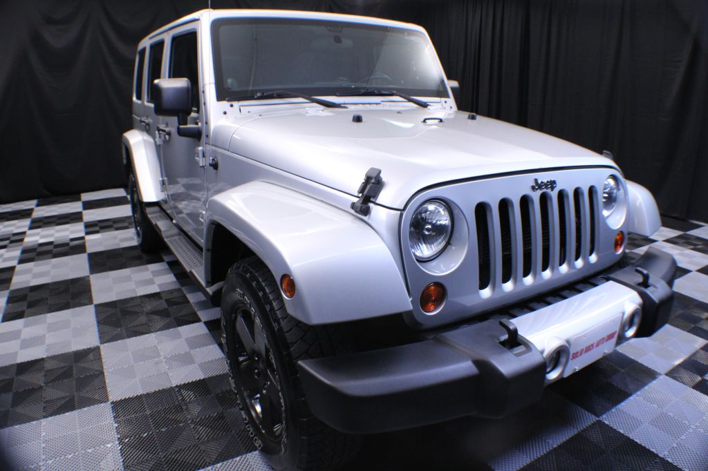 2012 JEEP WRANGLER UNLIMI SAHARA for sale at Solid Rock Auto Group