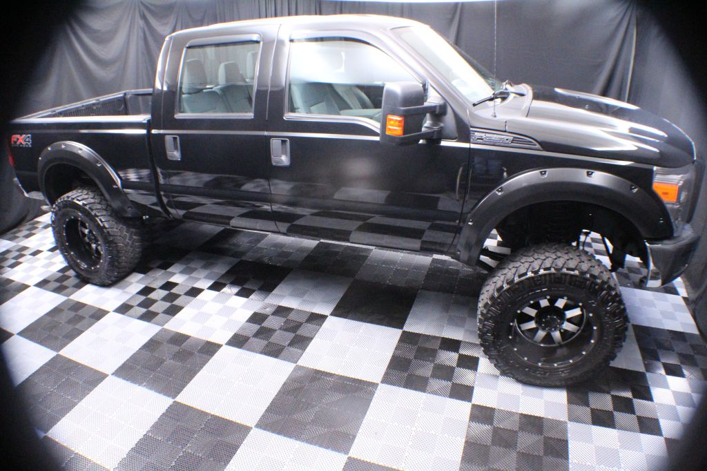 2015 FORD F250 8 IN LIFT SUPER DUTY for sale at Solid Rock Auto Group