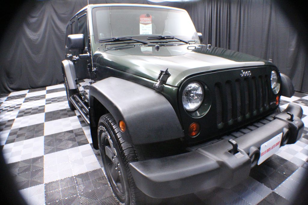 2012 JEEP WRANGLER UNLIMI for sale at Solid Rock Auto Group