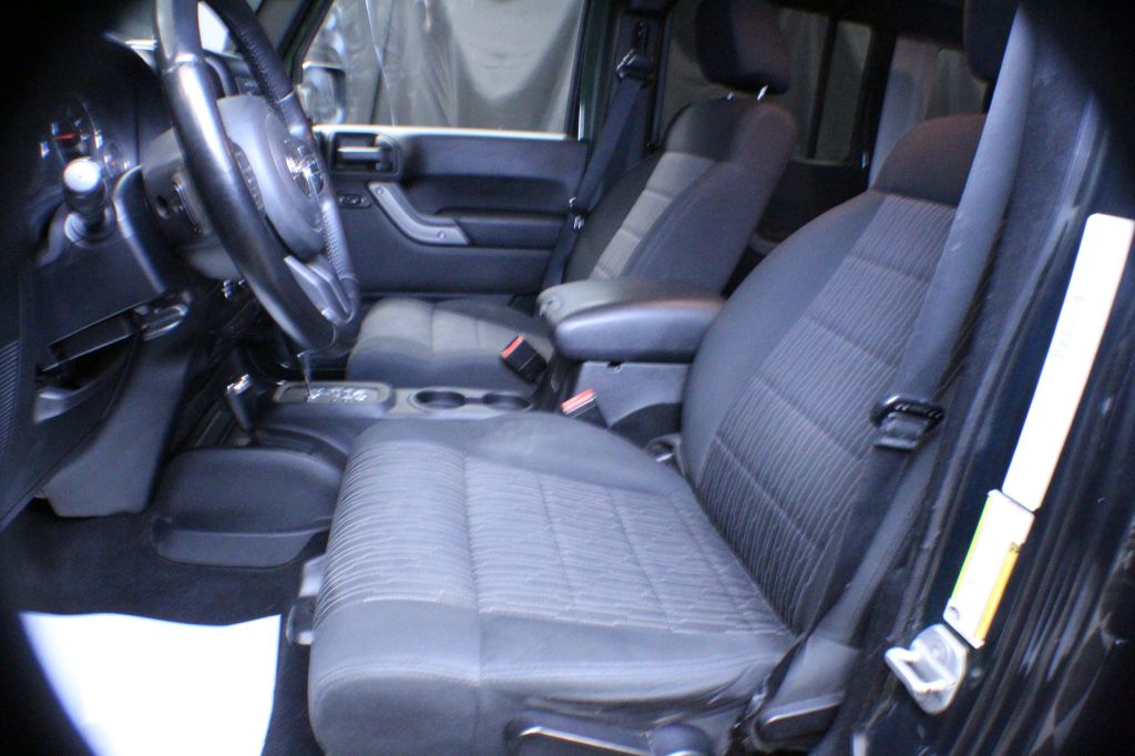 2012 JEEP WRANGLER UNLIMI SPORT for sale at Solid Rock Auto Group