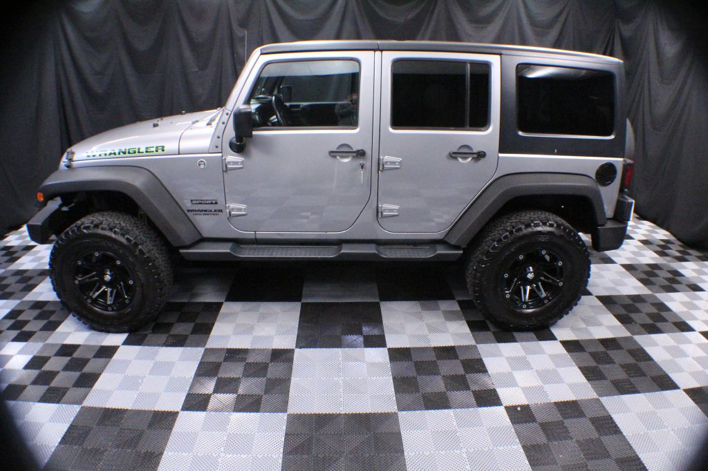 2013 JEEP WRANGLER UNLIMI SPORT for sale at Solid Rock Auto Group