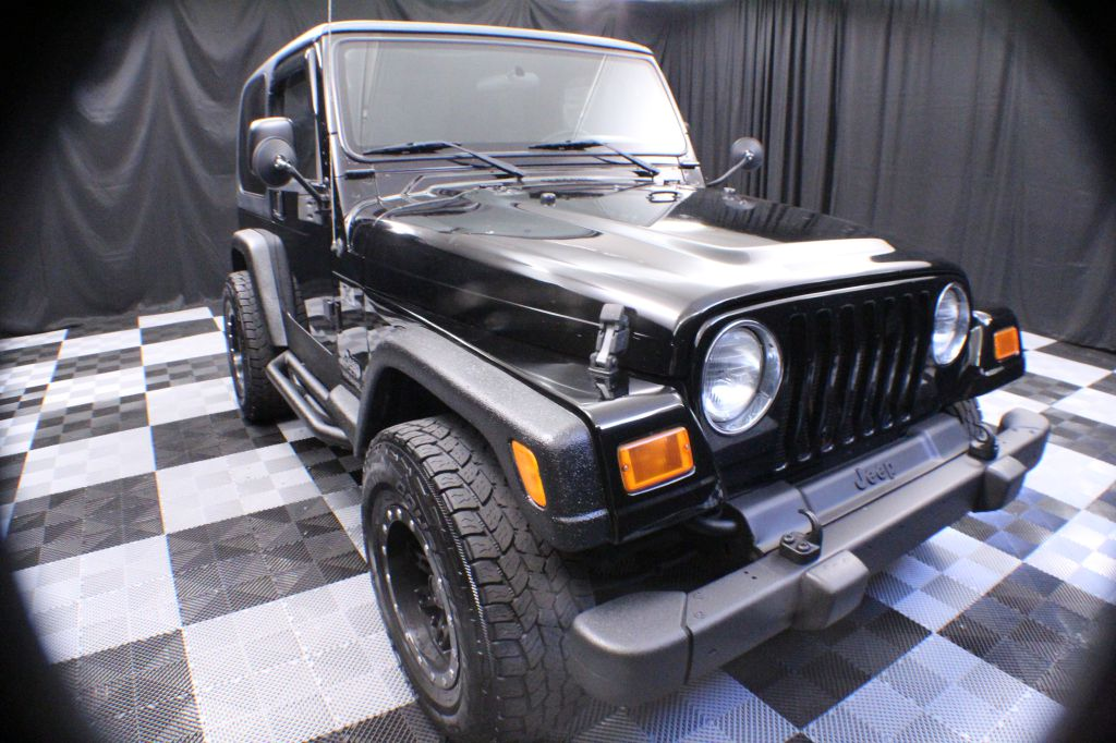 2004 JEEP WRANGLER for sale at Solid Rock Auto Group