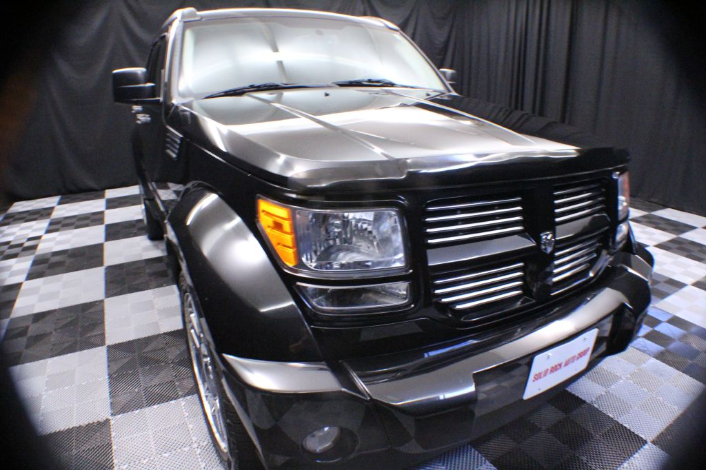 2011 DODGE NITRO for sale at Solid Rock Auto Group