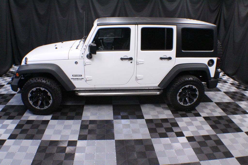 2014 JEEP WRANGLER UNLIMI SPORT for sale at Solid Rock Auto Group