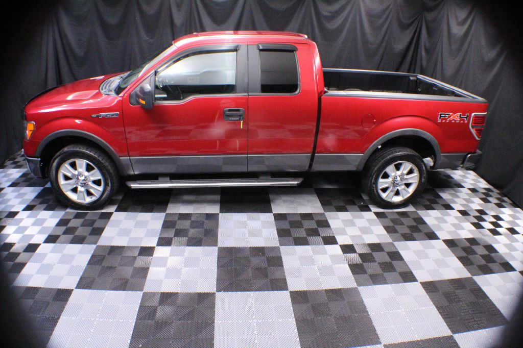 2009 FORD F150 SUPER CAB FX4 for sale at Solid Rock Auto Group