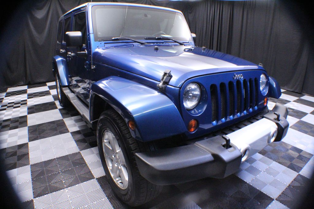 2009 JEEP WRANGLER UNLIMI for sale at Solid Rock Auto Group