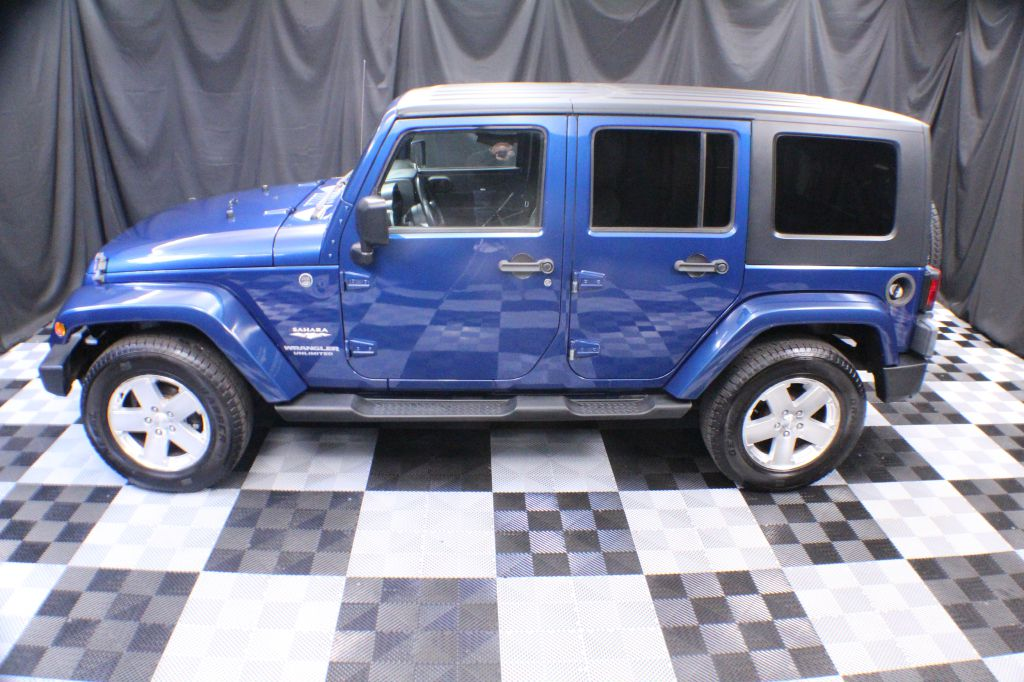 2009 JEEP WRANGLER UNLIMI SAHARA for sale at Solid Rock Auto Group