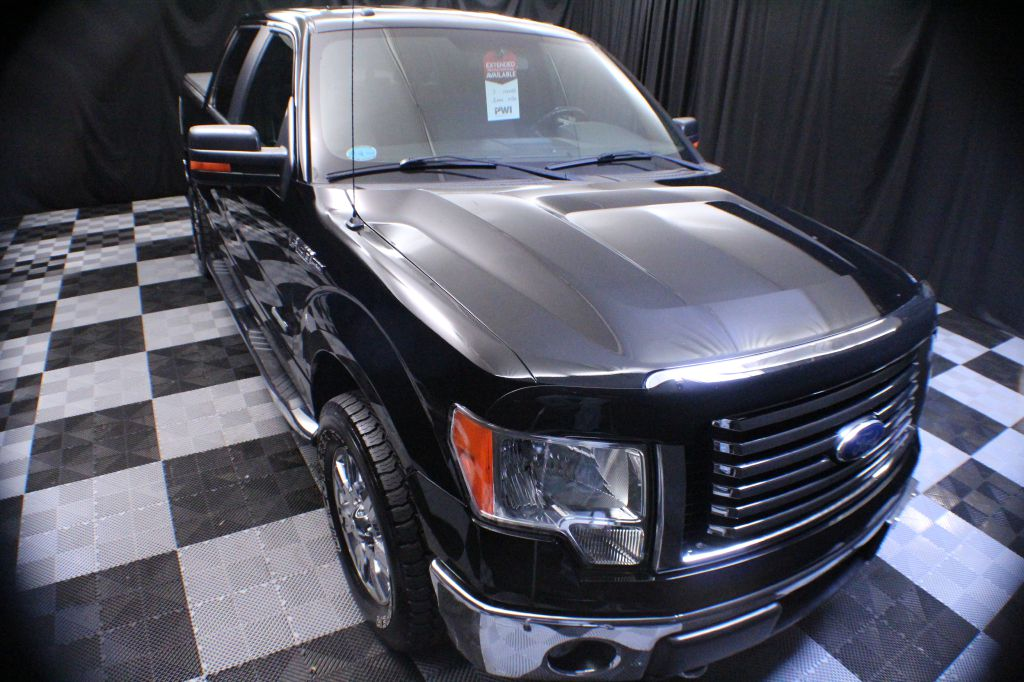 2011 FORD F150 for sale at Solid Rock Auto Group