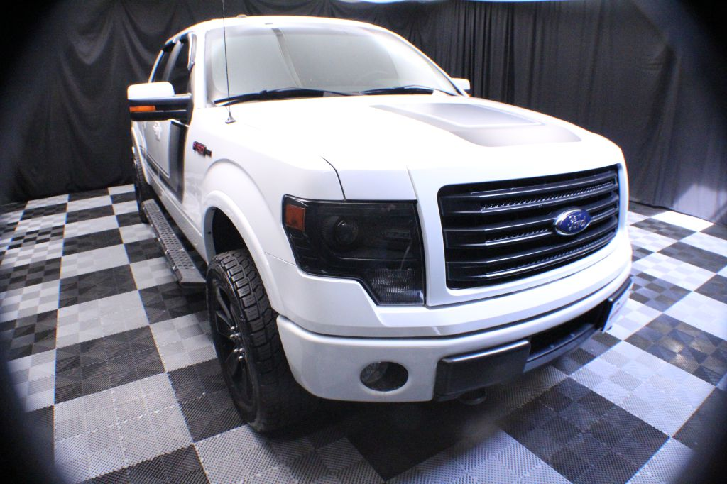 2014 FORD F150 for sale at Solid Rock Auto Group
