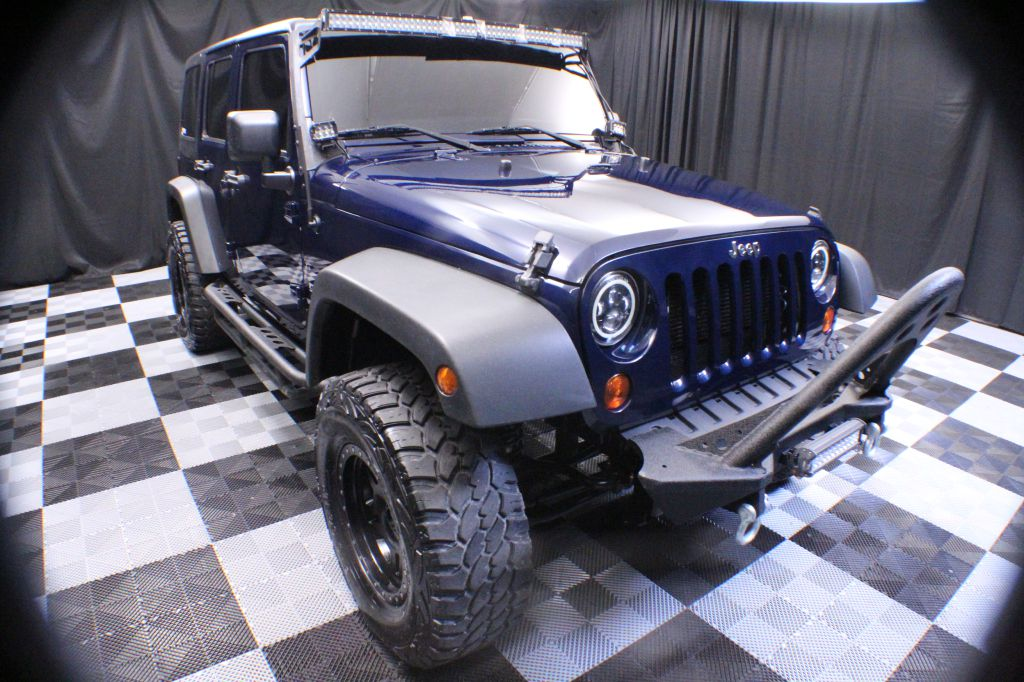 2013 JEEP WRANGLER UNLIMI for sale at Solid Rock Auto Group