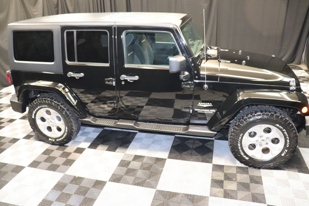 2013 JEEP WRANGLER UNLIMI SAHARA for sale at Solid Rock Auto Group