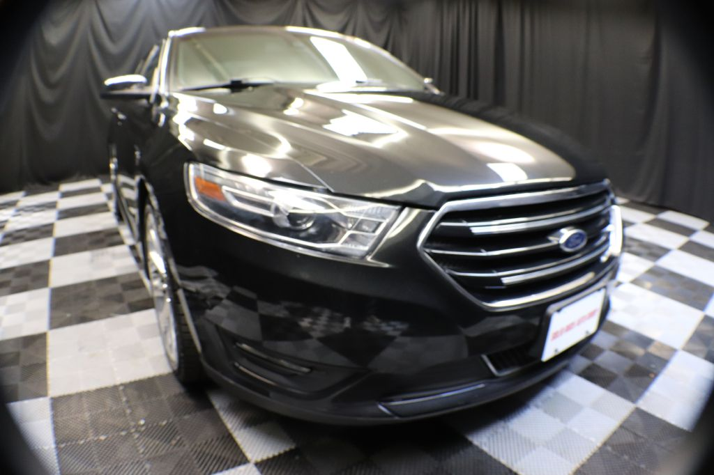 2015 FORD TAURUS for sale at Solid Rock Auto Group