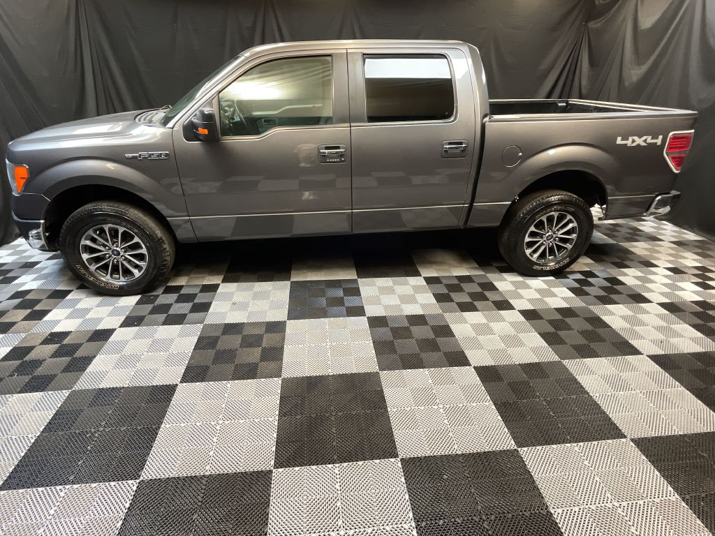 2011 FORD F150 SUPERCREW for sale at Solid Rock Auto Group