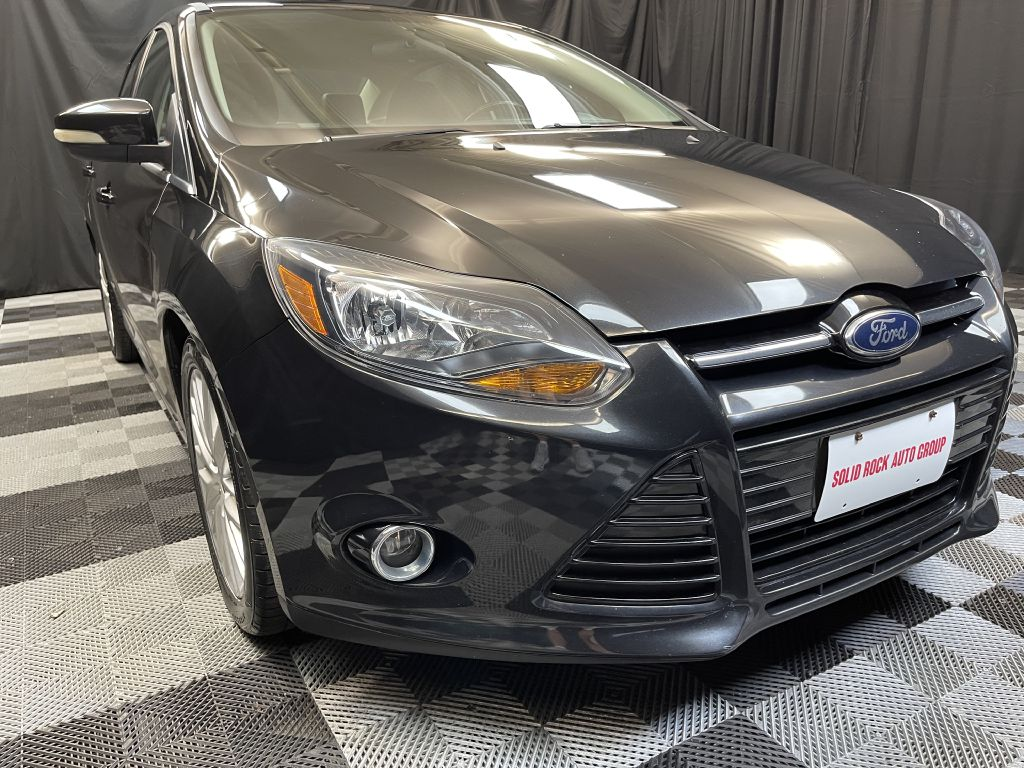 2013 FORD FOCUS for sale at Solid Rock Auto Group