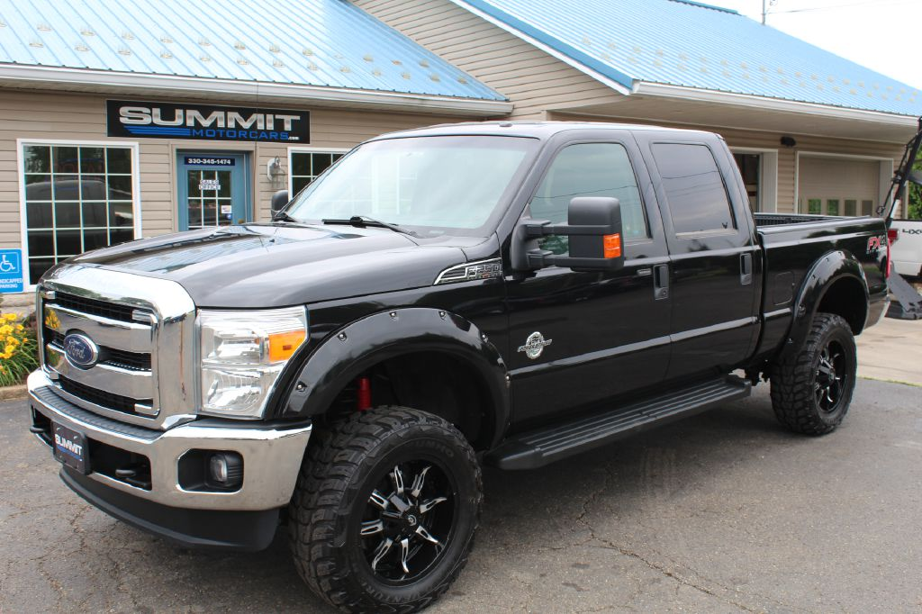 2014 FORD F250 SUPER DUTY LARIAT 4x4 POWERSTROKE for sale at Summit Motorcars