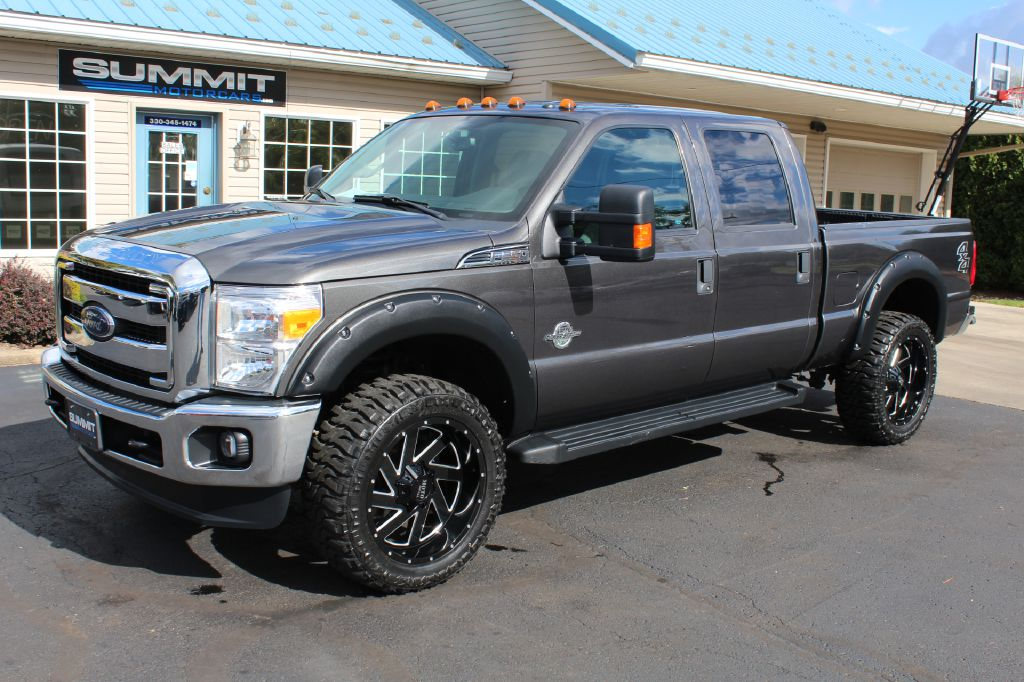 2014 FORD F350 SD LARIAT 4x4 POWERSTROKE for sale at Summit Motorcars