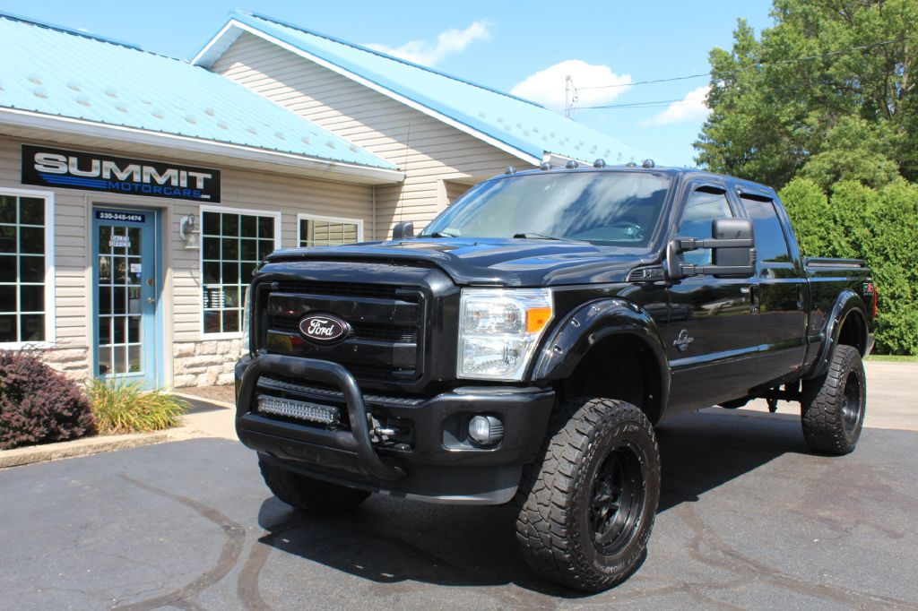 2015 FORD F250 LARIAT LARIAT 4WD POWERSTROKE for sale at Summit Motorcars