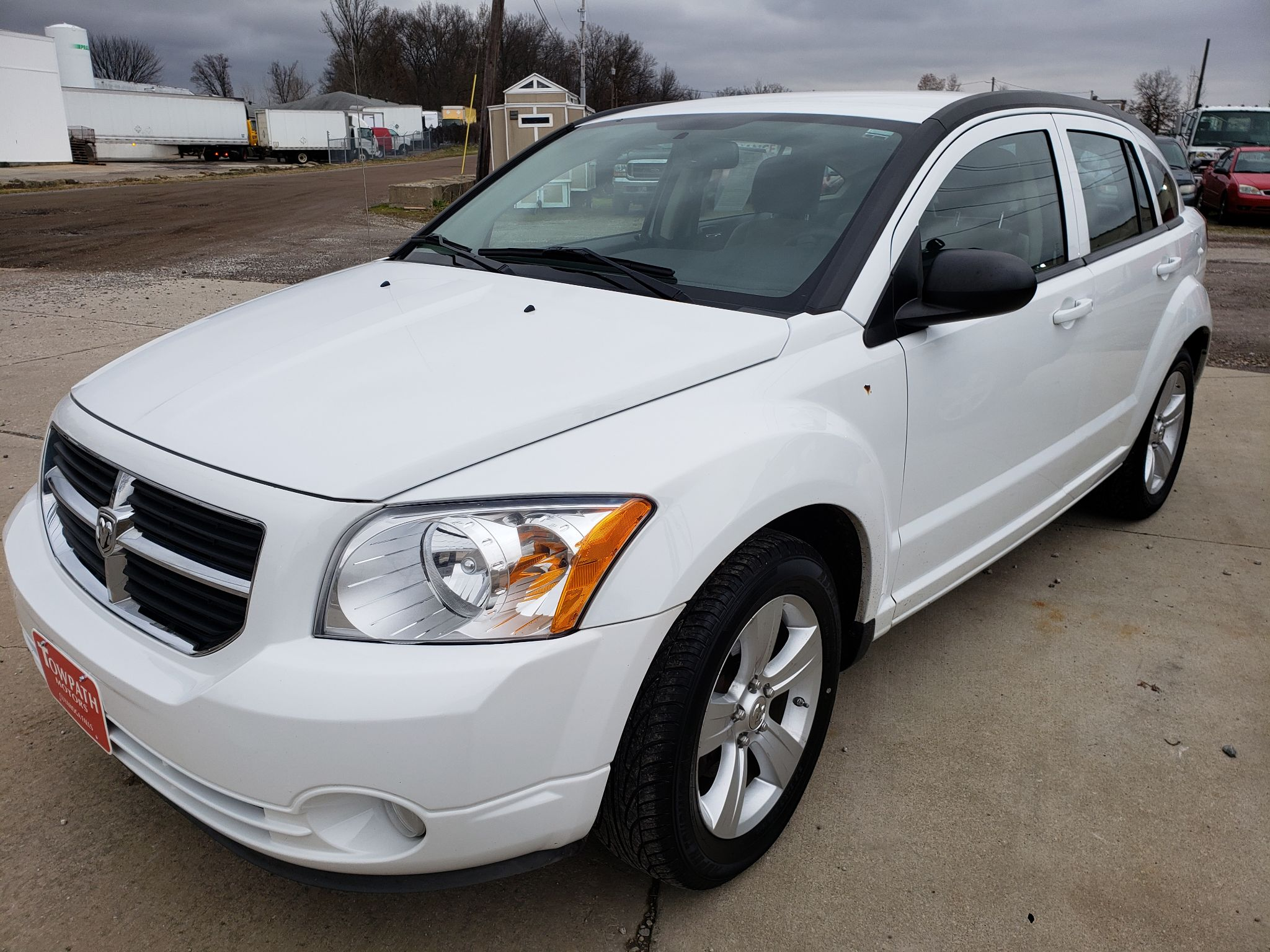 2012 Dodge Caliber for sale at Towpath Motors | Used Car Dealer in Peninsula Ohio