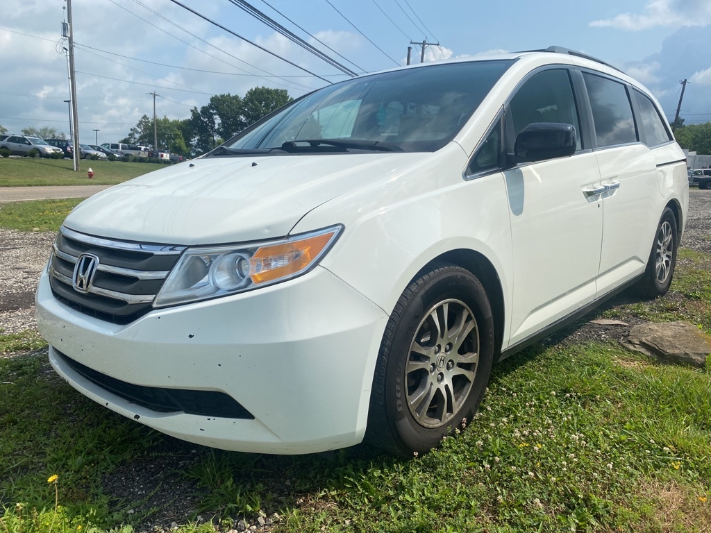 2013 Honda Odyssey for sale at Towpath Motors | Used Car Dealer in Peninsula Ohio