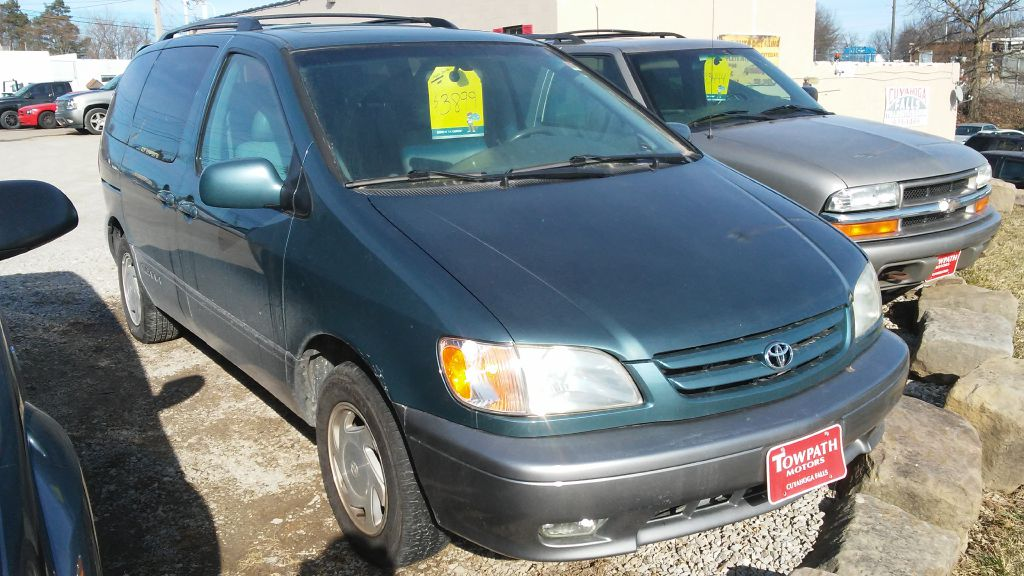 2002 Toyota Sienna for sale at Towpath Motors | Used Car Dealer in Peninsula Ohio