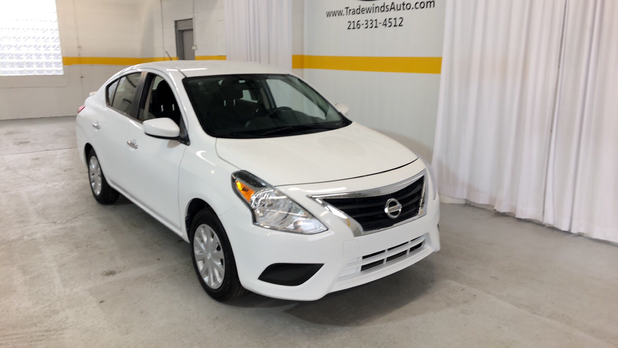 2017 NISSAN VERSA SV for sale at Tradewinds Motor Center