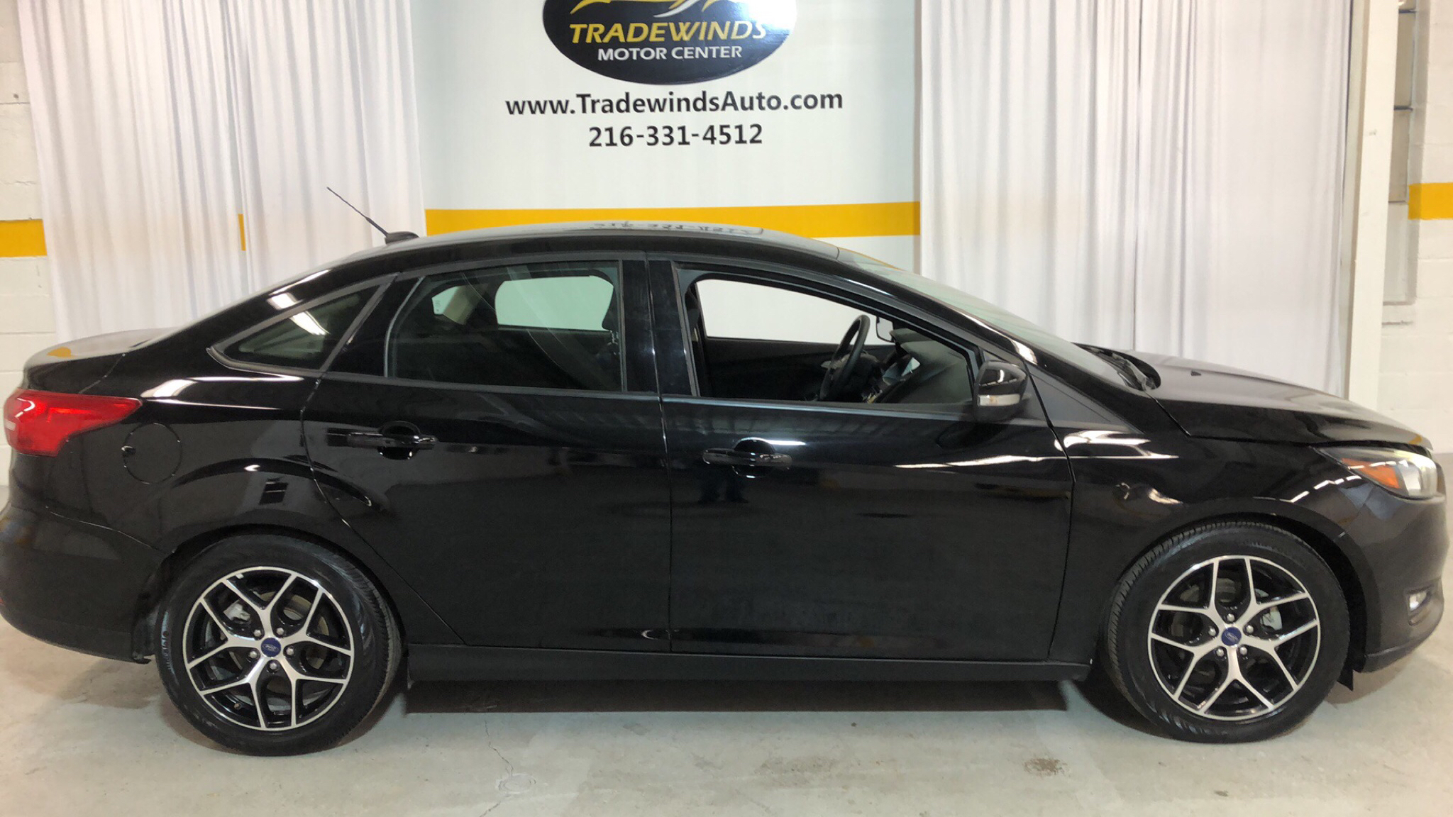 2017 FORD FOCUS SEL for sale at Tradewinds Motor Center