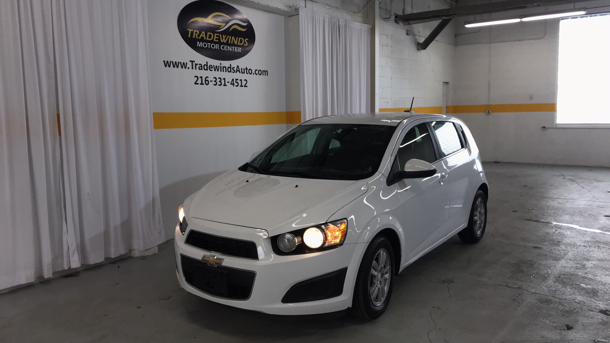 2015 CHEVROLET SONIC LT for sale at Tradewinds Motor Center