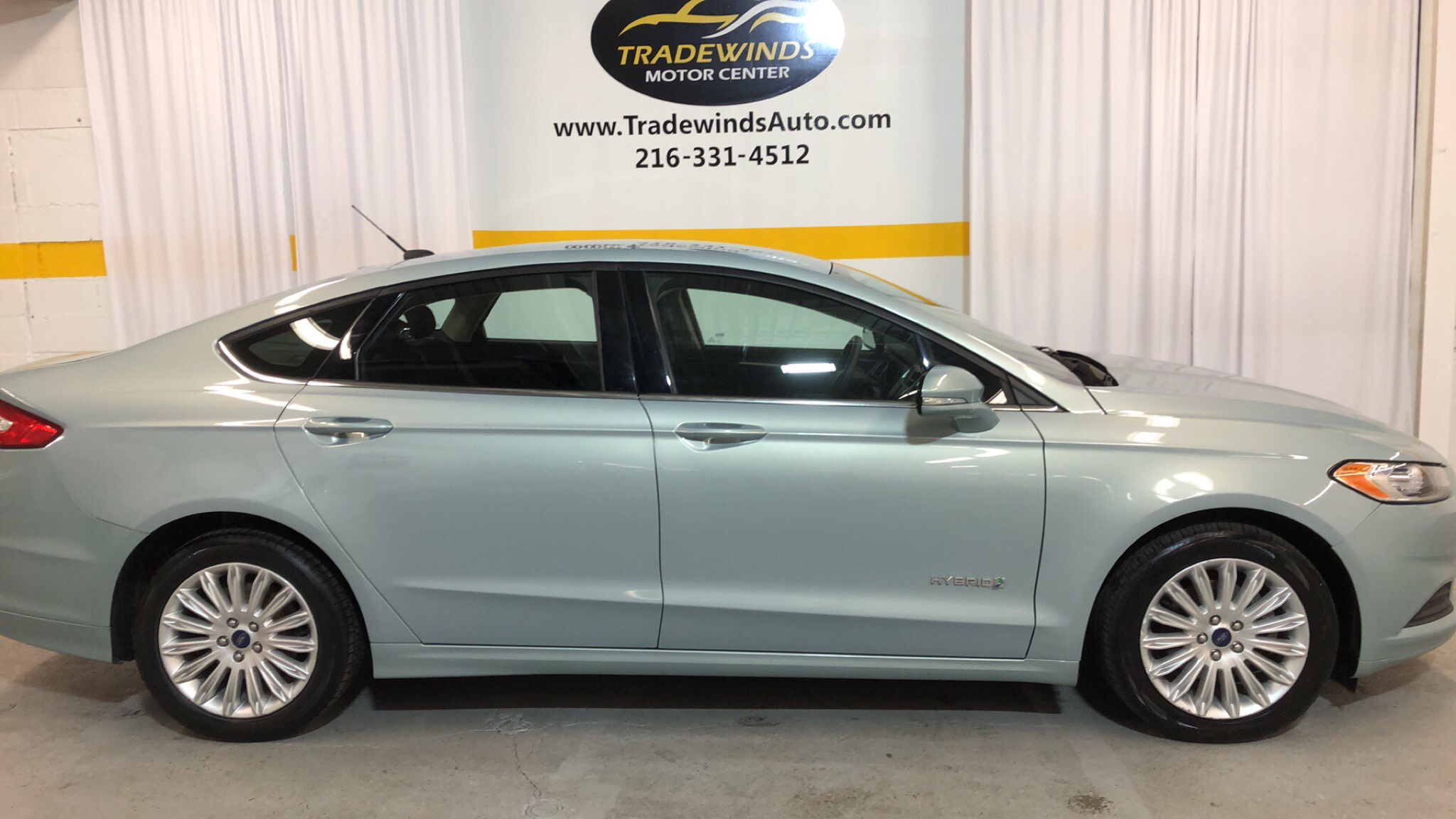 2013 FORD FUSION SE HYBRID for sale at Tradewinds Motor Center