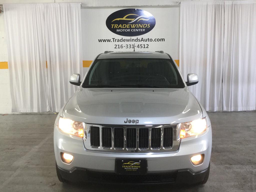 2012 JEEP GRAND CHEROKEE LAREDO for sale at Tradewinds Motor Center