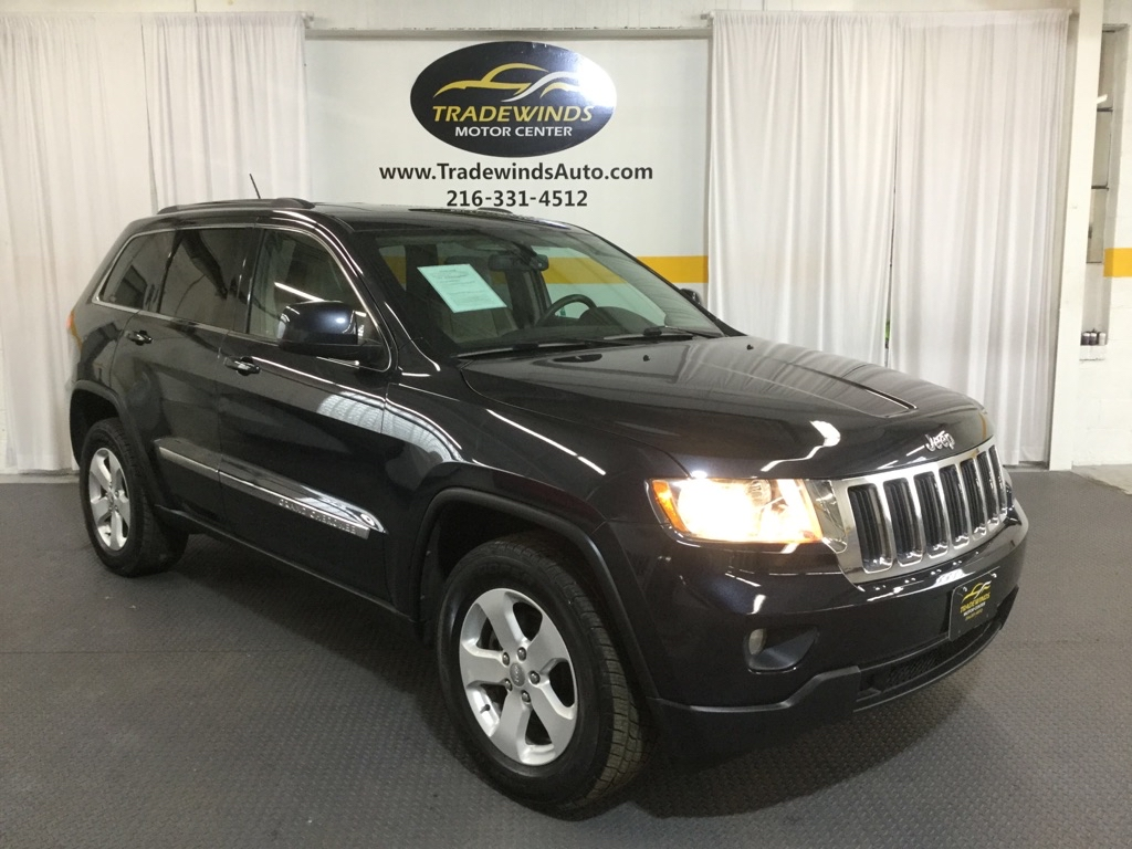 2013 JEEP GRAND CHEROKEE LAREDO for sale at Tradewinds Motor Center