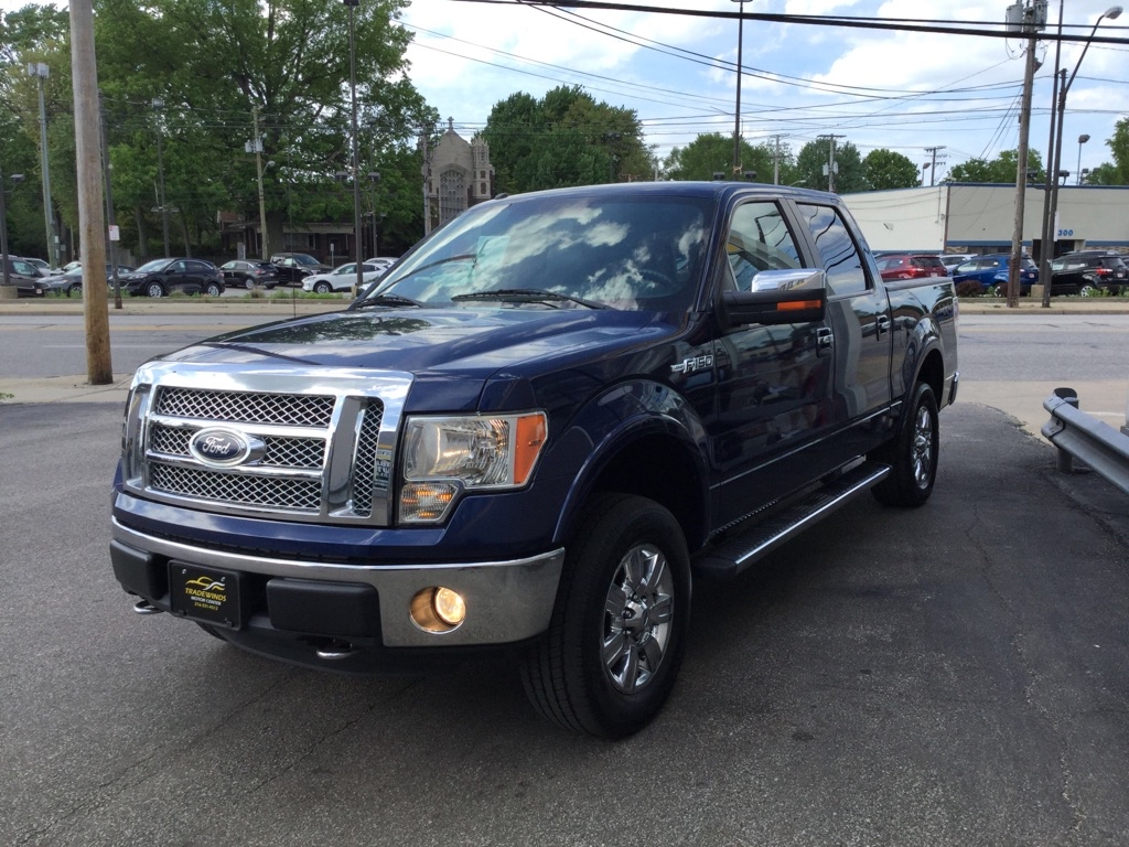 2011 FORD F150 LARIAT SUPERCREW for sale at Tradewinds Motor Center