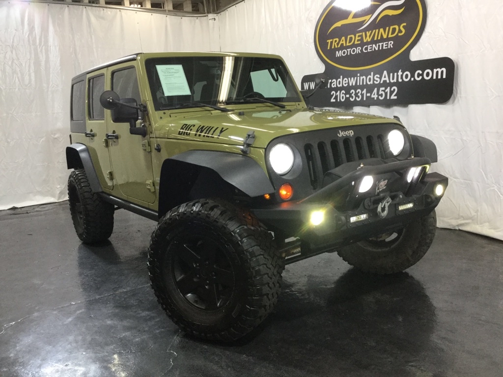 2013 JEEP WRANGLER UNLIMI SPORT for sale at Tradewinds Motor Center