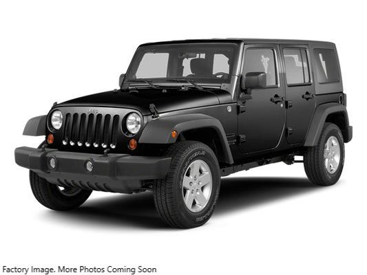 2013 JEEP WRANGLER UNLIMI SAHARA for sale at Tradewinds Motor Center