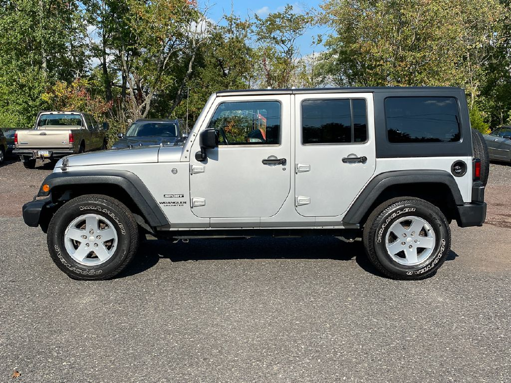 2012 JEEP WRANGLER UNLIMI SPORT for sale at Source One Auto Group